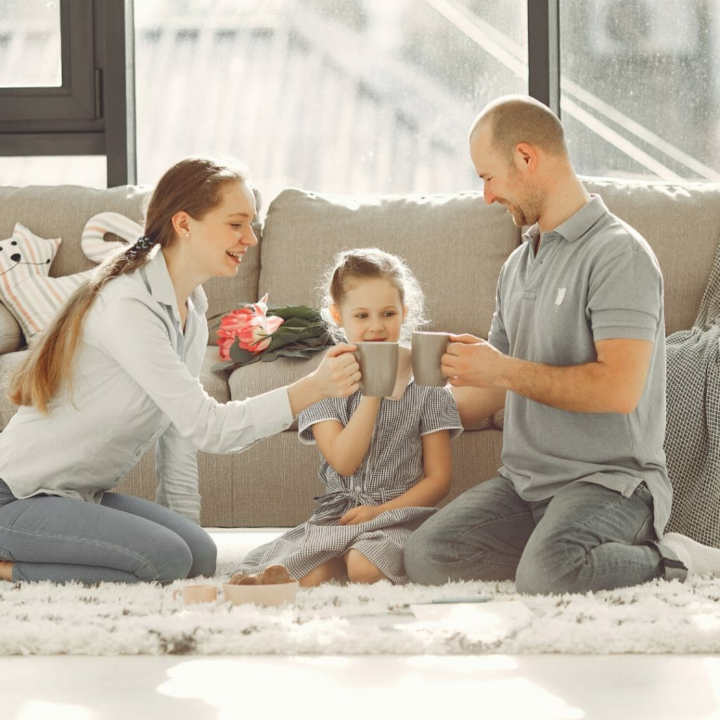family photo of two kids and one adult - entertain the kids during quarantine