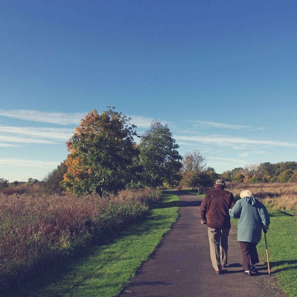 two retired people walking - money for retirement