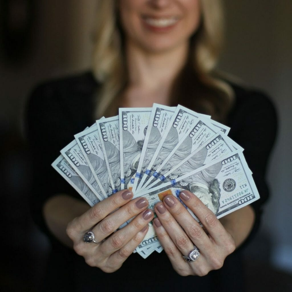 larger amount of money in womans hand